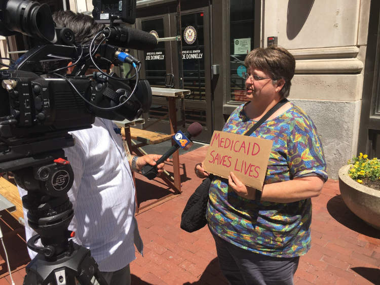 Woman giving a press interview